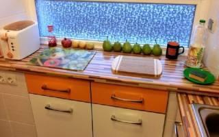 Как сделать шкаф под окном на кухне?